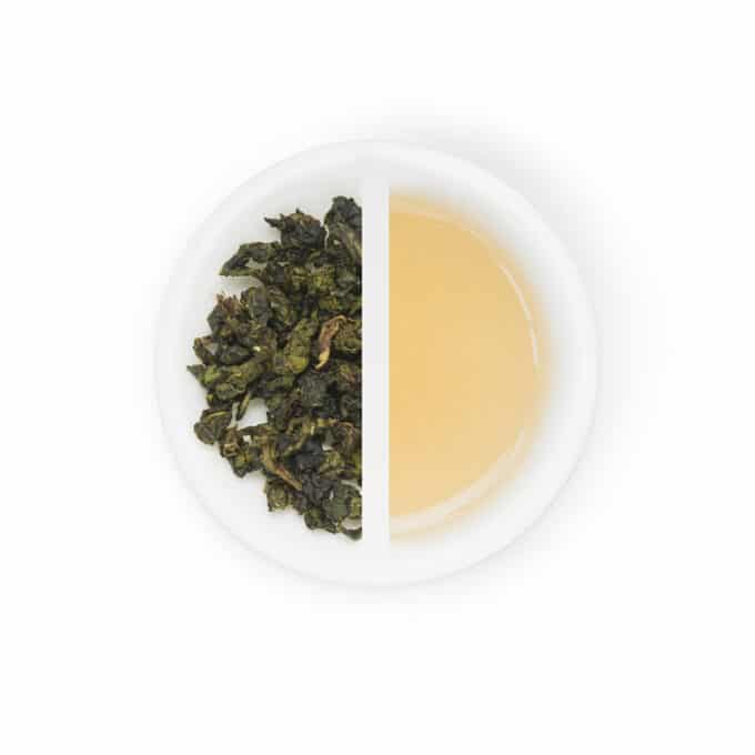 Milky oolong tea leaves on the left tea of milky oolong on the right